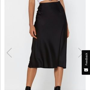 Nasty Gal Skirts - Black satin midi skirt